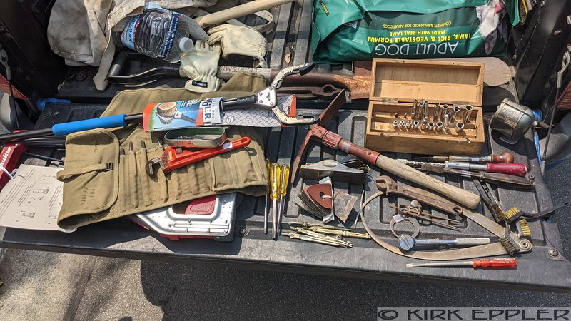 """L - R: Milwaukee folding cart, Unger Grabber, BG-46 Auger bit roll w all MF bits, 10"""" Ridge pipe wrench, box of watch openers, 3x Proto Screwdrivers, Folding Pick, 9-1/4 block plane, Fein Sanding backers, 4x German Silver drafting pieces, SK 1/4"""" socket set in Homemade wooden box,  Boston Pencil sharpener, 2x Yankee, All Steel Screwdriver, Barcalo 8"""" adjustable, MEigs Powell Huge Firm Joint Caliper, Caliper, AB firm joint caliper (apprentice project?) Bonney ratchet, Quick Wedge Screw holder, wire brushes."""