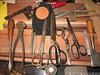 """Front L- R: German Perfect Handle type screwdriver, NOT beat to heck for a change, end cutters, 2x nail sets, 2x Wiss scissors, 2x Italian made scissors, silver lumber crayon, stanley 750 chisel, <br /> Back L-R ,  6"""" Brown & Sharpe square, Klein tool bag, home made double marking gauge."""