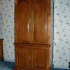 Pecan TV enclosure, pocket doors, hand veneered pecan panels, solid raised panel doors,ogee feet