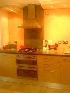 Howden Kitchen. Cooker hood mounted on worktop splash back. Light pelmets