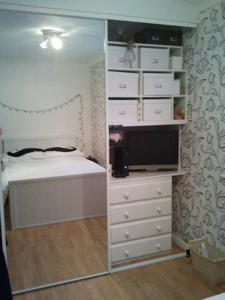 Sliding mirror wardrobe.Chest of draws hidden inside with TV and xbox above.Partitioned shelves for storage boxes.