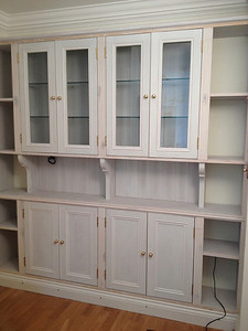 Built in hallway cupboard for display of cut glass and decanters