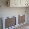 radiator cover fitted in kitchen , access panel on side for adjusting temperature and bleeding radiator