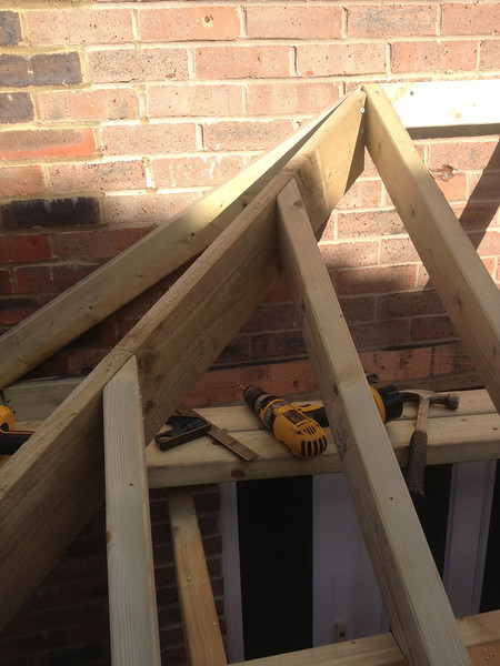 Hip roof , cut for porch