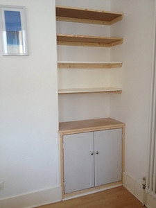 Simple cupboard and shelves above
