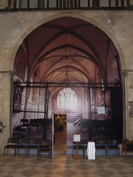 Chichester Cathedral.Large partition built. Picture of the Lady chapel was stuck on while the work was completed inside.Door access can be seen at the bottom