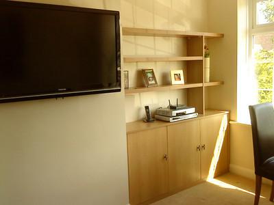 Modern alcove cupboard.