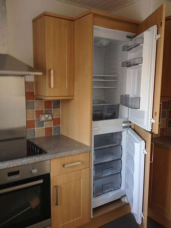 Kitchen with integrated fridge freezer