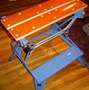 Bill Kasper's Probably UK made Workmate in Blue.<br /> Stained Ply top,not L shaped.  Note the extra hole in the center of the top