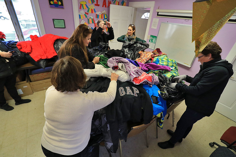 Worcester County Sheriff Lewis G. Evangelidis distributed thousands of winter coats to families & charitable organizations in need throughout Worcester County for the Sheriff's Annual Winter Coat Drive on Wednesday, December 5, 2018. One of their stops was the Spanish American Center in Leominster which got about 600 of the jackets they collected. Employess of the center and from the Sheriff's office get the coats ready for all that showed up to the center in need. SENTINEL & ENTERPRISE/JOHN LOVE