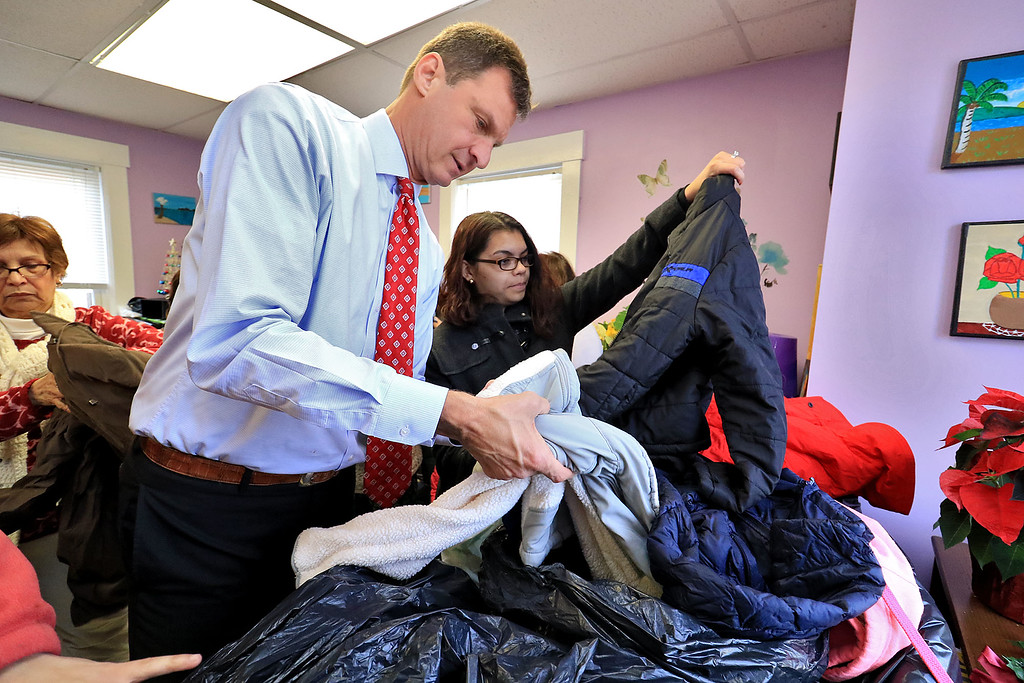 . Worcester County Sheriff Lewis G. Evangelidis distributed thousands of winter coats to families & charitable organizations in need throughout Worcester County for the Sheriff�s Annual Winter Coat Drive on Wednesday, December 5, 2018. One of their stops was the Spanish American Center in Leominster which got about 600 of the jackets they collected. Evangelidis helps Abeli ibarra of Leominser find a jacket that would fit her son before he had to run off and deliver more jackets to other cities and towns. SENTINEL & ENTERPRISE/JOHN LOVE