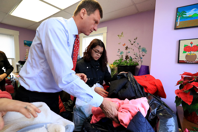 Worcester County Sheriff Lewis G. Evangelidis distributed thousands of winter coats to families & charitable organizations in need throughout Worcester County for the Sheriff's Annual Winter Coat Drive on Wednesday, December 5, 2018. One of their stops was the Spanish American Center in Leominster which got about 600 of the jackets they collected. Evangelidis helps Abeli ibarra of Leominser find a jacket that would fit her son before he had to run off and deliver more jackets to other cities and towns. SENTINEL & ENTERPRISE/JOHN LOVE