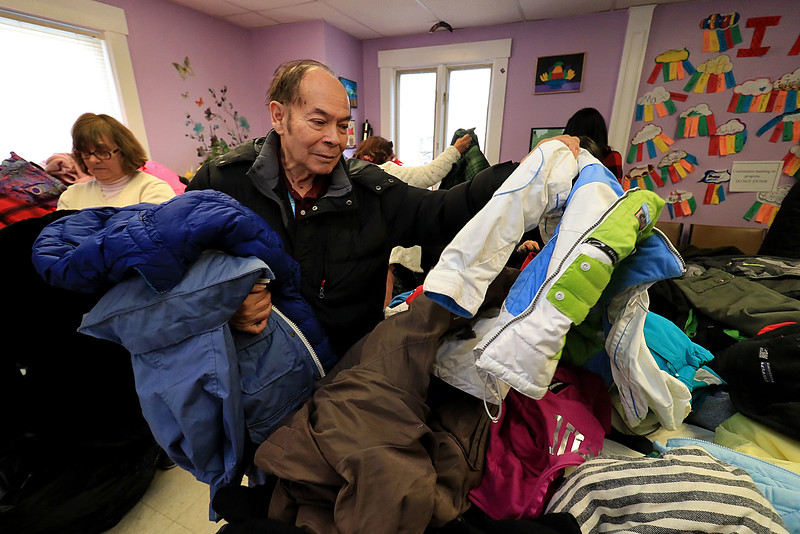 Worcester County Sheriff Lewis G. Evangelidis distributed thousands of winter coats to families & charitable organizations in need throughout Worcester County for the Sheriff's Annual Winter Coat Drive on Wednesday, December 5, 2018. One of their stops was the Spanish American Center in Leominster which got about 600 of the jackets they collected. Hugo Pesantes looks for jackets for each member of his family. SENTINEL & ENTERPRISE/JOHN LOVE