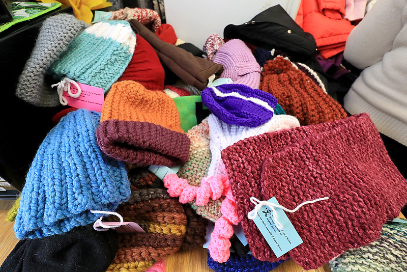 Worcester County Sheriff Lewis G. Evangelidis distributed thousands of winter coats to families & charitable organizations in need throughout Worcester County for the Sheriff's Annual Winter Coat Drive on Wednesday, December 5, 2018. One of their stops was the Spanish American Center in Leominster which got about 600 of the jackets they collected. Some of the hats donate to center from Leominster's Warmer Winters group. SENTINEL & ENTERPRISE/JOHN LOVE