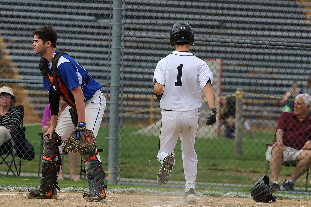 . Worcester Tech baseball played St. Bernard\'s High School at St. Bernard\'s Activity Complex in Fitchburg Thursday afternoon, May 3, 2018. St. B\'s player Jack Mammone scoresnduring the game. SENTINEL & ENTERPRISE/JOHN LOVE