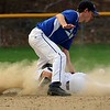 Worcester Tech baseball played St. Bernard's High School at St. Bernard's Activity Complex in Fitchburg Thursday afternoon, May 3, 2018. St. B's player Jack Mammone slides through the legs of WTHS player Andrew Pepper as he steals second during action in the game. SENTINEL & ENTERPRISE/JOHN LOVE