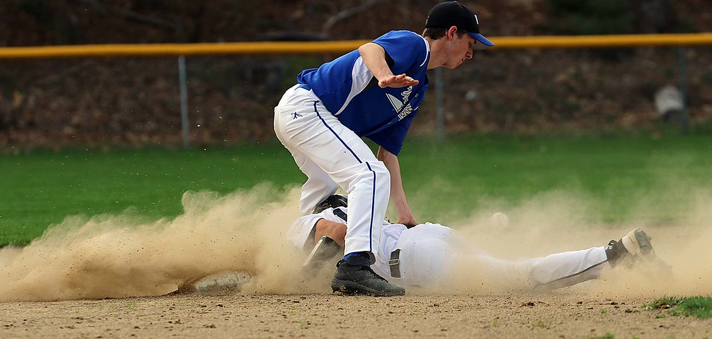 . Worcester Tech baseball played St. Bernard\'s High School at St. Bernard\'s Activity Complex in Fitchburg Thursday afternoon, May 3, 2018. St. B\'s player Jack Mammone slides through the legs of WTHS player Andrew Pepper as he steals second during action in the game. SENTINEL & ENTERPRISE/JOHN LOVE
