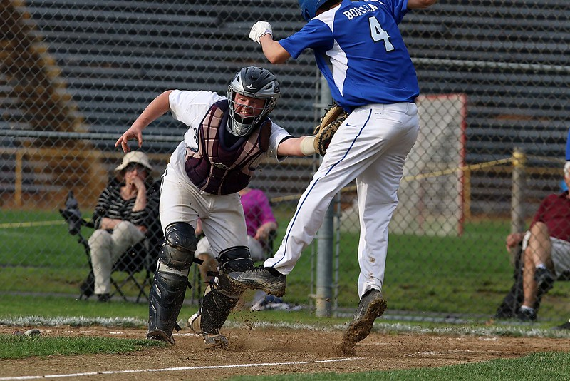 Worcester Tech baseball played St. Bernard's High School at St. Bernard's Activity Complex in Fitchburg Thursday afternoon, May 3, 2018. WTHS Jose Bonilla is tagged out at home by ST. B's catcher Jon Pinard during action in the game. St. Bernard's won, 3-2. SENTINEL & ENTERPRISE/JOHN LOVE