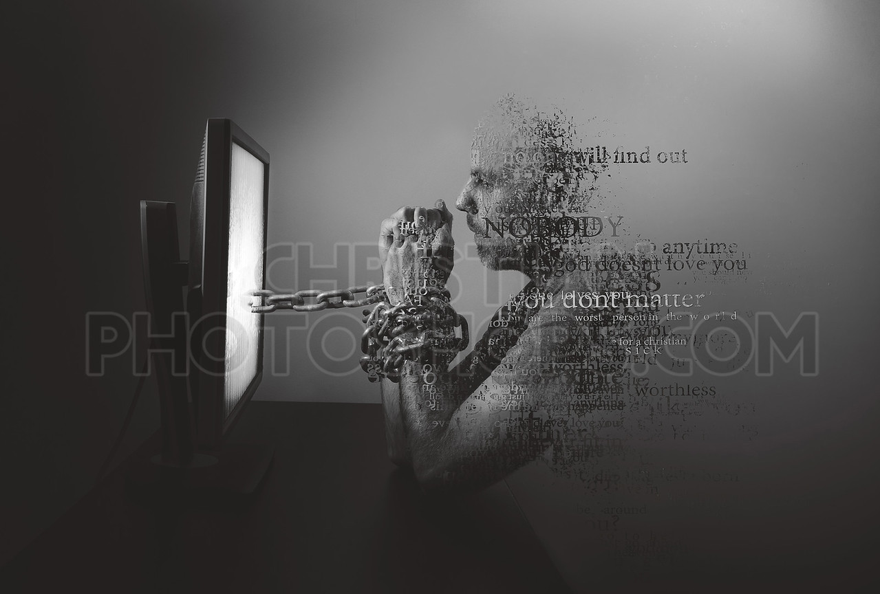 A man chained to a computer