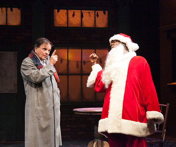 "Santa (Rotimi Agbabiaka) takes a punch at an inquisitive parent (Paul Finocchiaro)""Dancing Dan's Christmas""     photo credit:  Julie Schuchard"