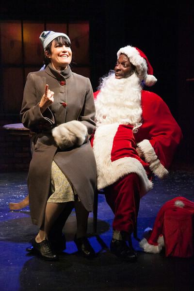 "Santa (Rotimi Agbabiaka) gets a little peevish with a child's request (Lisa Hori-Garcia)    ""Dancing Dan's Christmas""  Photo credit:  Julie Schuchard"