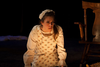 "Franny (Rosie Hallett) waits to hear her fate.   From Emma Donoghue's ""Night Vision.""Word for Word's Stories by Emma Donoghue and Colm Tóibín at Z Below, Feb 24th through April 3rd, 2016.Photo credit: Julie Schuchard"