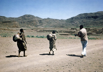 Mohinder Dhillon filming Ethiopian women walking with clay water containers, 1986