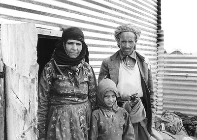 Earthquake Victims outside Corrugated Metal Temporary Home,  June 1983