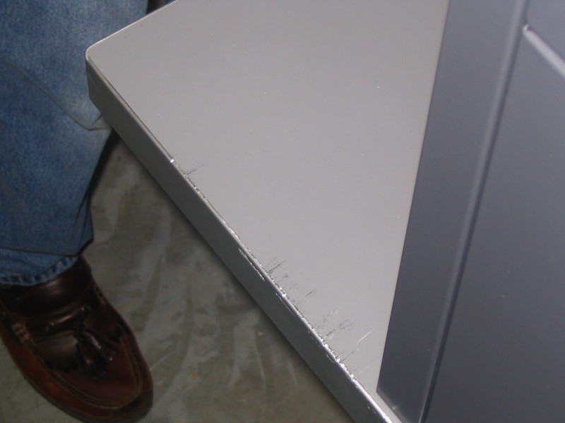 Note damage to laminate countertop and edge binder.  This unit was received at the store without a bottom skid, and the packaging severely damaged.
