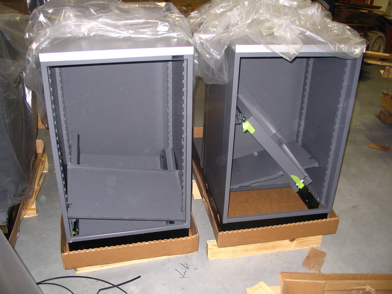 Second cabinet with pull-out shelf assembly.  Note that cabinet was subjected to severe handling, causing assembly to be knocked out of its mounting on one side, causing severe twisting and bending to connected side.