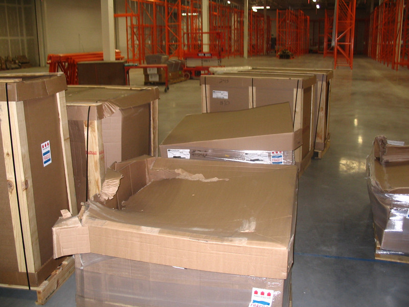 Note damaged packaging, including crushed and punctured cardboard