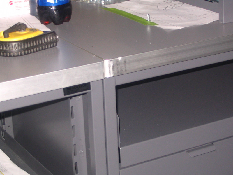 Note damage to edge binder of countertop