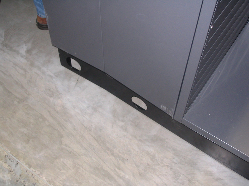 Note damage to base of cabinet, as well as scrapes and scuffs on side of cabinet