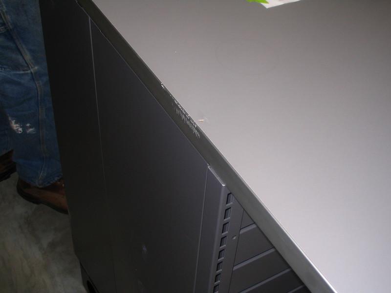 Note damage to laminate top and edge binder