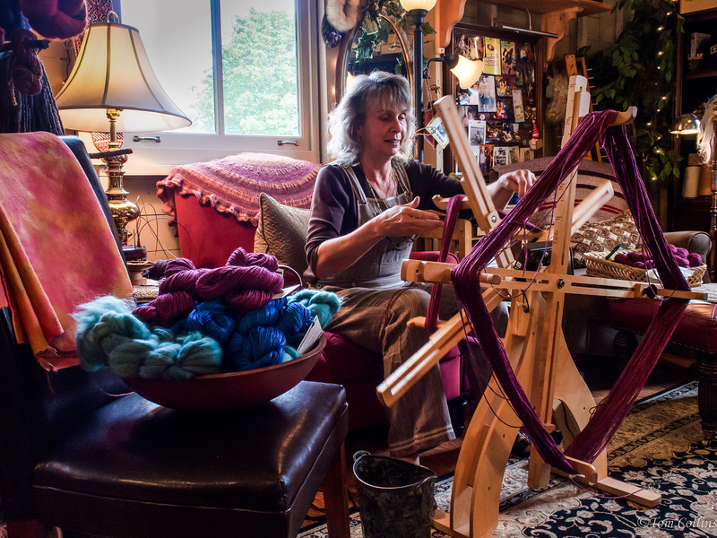 """Heidi Dascher, owner and creator of """"The Artful Ewe"""" in Historic Port Gamble, Washington.  Heidi spins yarn and dyes the multitude of beautiful colors for other artisans to use in their creations by knitting and weaving the yarn into beautiful sweaters, hats, scarfs and blankets.  Visiting her two shops in Port Gamble is nothing short of a treat for the eyes and a warming of the soul.  The explosion of colors and the warm vibe you get in Heidi's shop has a soothing feeling that brings a sense of comfort immediately.  One visit here and you'll go home with something beautiful, colorful, warm and that will last a life-time."""