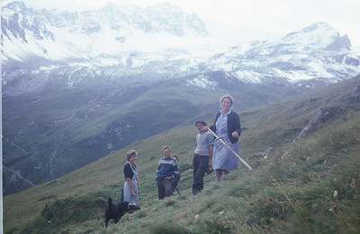 Cutting hay.  I often helped the Clopath family.  Note the steepness and that the women are in skirts.