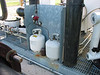 These propane tanks are used to light the flare's pilot light. It is only used to light the flare, then goes off; and it is only turned on when they know they will be using the flare.