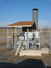 On to the industrial facilities!  This facility had a methane-to-energy facility in place from the 1980s through to May, 2007. The landfill's growth outstripped the facility's ability to collect methane, so a flare was put into operation in 2002.  This photo shows the flare, its meters, and an obstructed view of the water knock-out equipment which dries the gas before it is flared.  This flare is no longer in constant use (due to 2007 project).