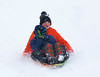 HOLLY PELCZYNSKI - BENNINGTON BANNER Nat Greenslit, 12 years old of Shaftsbury sleds down a hill with his 9 year old brother Seth as he covers his eyes on the way down the hill at The Norshaft Lions Club Park in North Bennington.