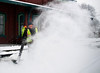 HOLLY PELCZYNSKI - BENNINGTON BANNER Matt Razanouski, blows snow off the train tracks in North Bennington on Wednesday morning.