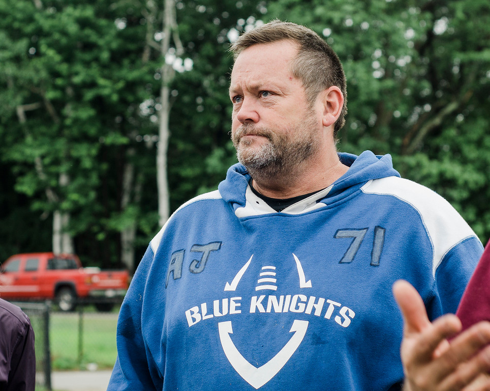 . Scott Robbins, the father of former Lunenburg High student and football player A.J. Robbins, watches as ground is broken on the new field house at LHS on Saturday, June 17, 2017. Robbins died on August 27, 2016 in a drunk driving accident. The new field house will be dedicated in his honor. SENTINEL & ENTERPRISE / Ashley Green