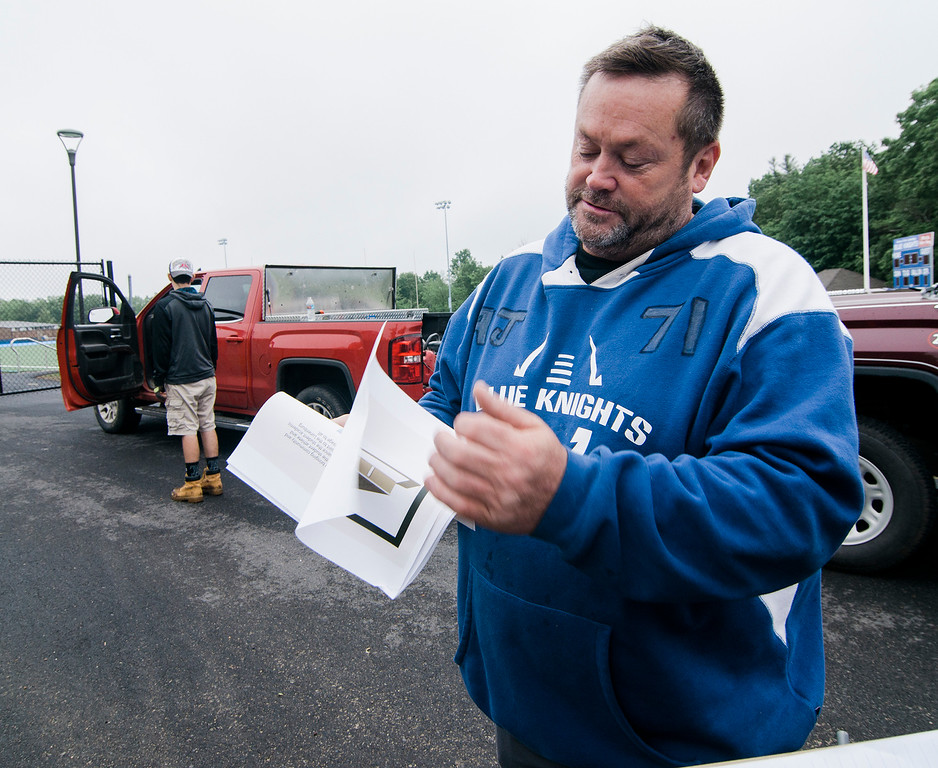 . Scott Robbins, the father of former Lunenburg High student and football player A.J. Robbins, looks over plans for the new field house at LHS on Saturday, June 17, 2017. Robbins died on August 27, 2016 in a drunk driving accident. The new field house will be dedicated in his honor. SENTINEL & ENTERPRISE / Ashley Green