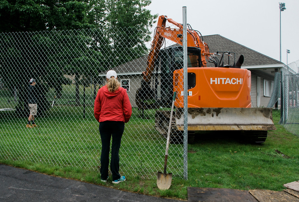 . Carol Robbins, the mother of former Lunenburg High student and football player A.J. Robbins, watches as ground is broken on the new field house at LHS on Saturday, June 17, 2017. Robbins died on August 27, 2016 in a drunk driving accident. The new field house will be dedicated in his honor. SENTINEL & ENTERPRISE / Ashley Green