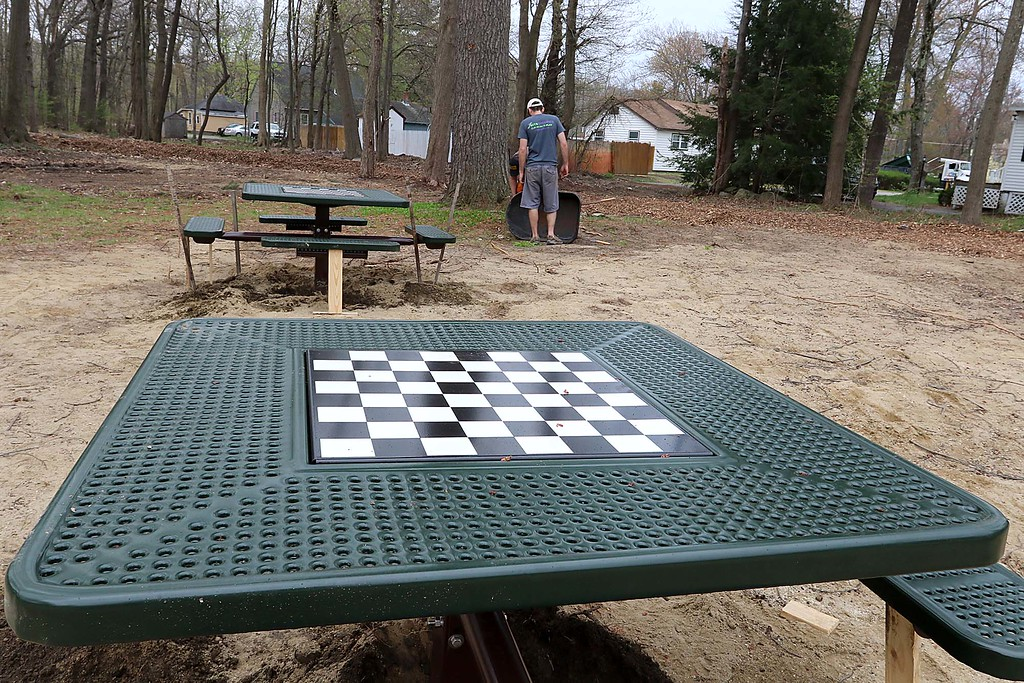 . Work was underway to put in Wallis Park Playground that was funded through a citizens petition on Friday morning in Lunenburg. One of the things put into the park was tables with chess boards on them. SENTINEL & ENTERPRISE/JOHN LOVE