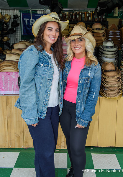 Savannah Viggiano, left, and her mother, Melisa Viggiano, both of Stamford, Connecticut, try on cowboy hats at Leon Leather on the second day of The Big E 2019 in West Springfield on Saturday. (Steven E. Nanton photo)