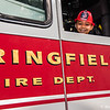 Amir Glaze, 4, of Springfield, peers out the window of a Springfield Fire Department Heavy Rescue Truck at Springfield BID's Cruise Night at Court Square on Monday. (Steven E. Nanton photo)