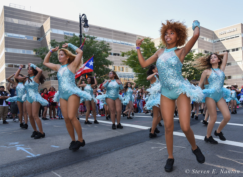 Members of a dance group perform at the Springfield Puerto Rican Parade on Main Street on Sunday. (Steven E. Nanton photo)