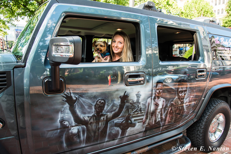 Ashley Di Santi, of East Longmeadow, holds her dog, Teddy, as they sit in her father Glen Lamontagne's  Hummer at Springfield Business Improvement District's Cruise Night on Monday at Court Square. (Steven E. Nanton photo)
