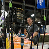 Cody Gentilella adjusts his display at Reel Deal at the 2018 Springfield Sportsmen's Show at Eastern States Exposition in West Springfield on Friday. (Steven E. Nanton photo)