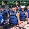 Members of the Titans Team smile for a photo at the seventh annual Springfield Dragon Boat Festival on the Connecticut River on Saturday. (Steven E. Nanton photo)
